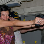 Jen Leo, Ponzi and Jennifer doing 9mm competency shooting in a simulator on board the USS Green Bay